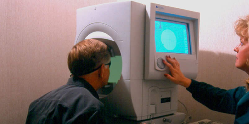 Ophthalmologist administering a Perimetry test