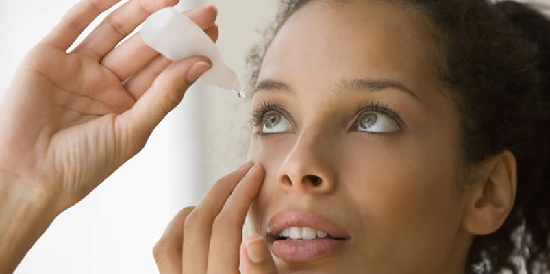 Woman using eye drops for her Dry Eyes